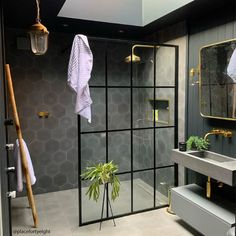 Black bathroom design combined with many golden accents! Who also loves a walk-. Hexagon Tile Bathroom, Black Hexagon Tile, Hexagon Tiles, Bathroom Wall Tiles, Bathroom Tile Showers, Cement Bathroom, Jungle Bathroom, Tiled Showers, Washroom