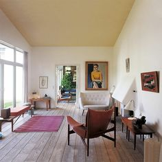 wide plank floors + painting + windows + high ceilings + little fireplace + big windows = love