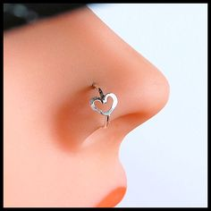 Hammered Heart Sterling Catchless / Seamless Nose Ring - CUSTOMIZE. $19.95, via Etsy.