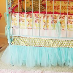 I hate the bedding and colors but love the idea of tulle (sp?) as the bed skirt