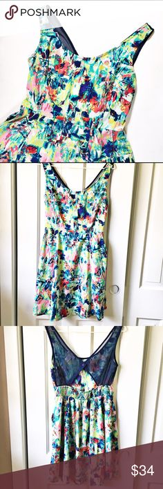 Band of gypsies cut out back dress with pockets This dress has A great cut out with pockets and an elastic waist band. The colors are fun and exciting, right for the spring season! Band of Gypsies Dresses Midi
