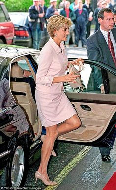 This blush pink day suit, worn to a children's bravery awards at the Savoy Hotel in 1997, is a beautiful example of how Diana had pared down her style post-divorce