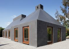C-House, Kildare, Ireland. Irish architects Dot Architecture and Soc-Arc designed the walls and sloping roofs of C-House on top of the substructure of an existing house that had been irreparably damaged by flooding.
