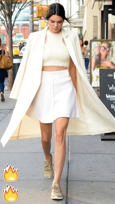 Kendall Jenner's best outfits: Cream crop top, A-line skirt and coat