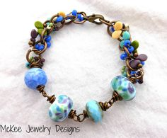 Purple, blue, green, cream glass and metal bracelet. -  - McKee Jewelry Designs - 1