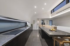 Hidden scullery and pop up tv that's concealed this kitchen really has all the modern conveniences. Visit to see more of this project by Perth luxury home builder Weststyle.