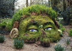 Head and face soil mound. Art of Nature