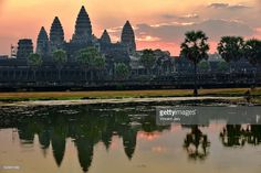 Cambodia, Siem Reap, Angkor Wat temple at sunrise with ornage sky with reflection . Cambodia. Asia. #photo #getty #gettyimages #images #picture #travel #traveling #www.vincent-jary.fr #photograph #traveler #UNESCO #civilisation #buddhism #temple