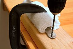 Making bracelets, coat hooks, drawer handles or windchimes out of flatware requires drilling a hole in each piece, typically in the handle. To drill the hole successfully, you need a vise to hold the piece steadily as you drill; otherwise the drill bit may catch on the curves and angles on the handle or bowl of the piece being drilled. Wrap the...