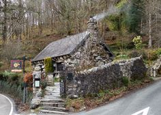 The Ugly House, near Betws-y-Coed, North Wales. Log fire burning, people sitting in the back garden enjoying tea and cakes. A lovely Border Collie strolling through the daffodills. jp.photo.31MAR2015.
