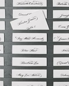 Polished Escort Card Display:   Slip cards into sleek pewter ribbons for a chic presentation.     The Details: Escort cards, Crane & Co., 800-268-2281; 2 3/4 ribbon in fawn, Midori.
