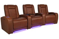 The Aston home theater seating group from Seatcraft offers razor-sharp contemporary style, in a design and color sure to accentuate any style of décor.  Included tray tables allow one to place food, tablets, cell phones, magazines and other items within simple arm's reach, while a USB lets one charge cell phones and tablets with ease.