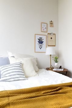 Love this Scandinavian bedroom. Ocher yellow in a white bedroom.