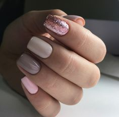 Taupe monochromatic nails with creamy, opaque pink and sparkly pink accent nails to make the neutral colors pop in this perfect manicure.