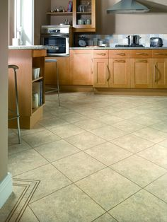Karndean ST5 Soapstone Knight Tile Vinyl Flooring has the tumbled, filled look of a genuine soapstone in gentle pale tones. Yet it has none of the porosity or coldness of real stone tiles. If you want to achieve the same look as the picture, you'll need to add the DS14 Stone 3mm design strip. Karndean Knight Tile, Karndean Flooring, Granite Flooring, Luxury Vinyl Tile Flooring, Vinyl Tiles, Kitchen Tiles, Kitchen Flooring, Natural Stone Flooring, Soapstone