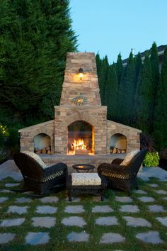 Awesome Landscape Design Ideas For Outside Fireplace Your Dreams: Fantastic Outside Fireplace With Surrounded Green Trees And Concrete Pavers Also Faux Stone Plus Fireplace With Firewood Storage And Grass Grout Also Wicker Patio Chair For Traditional Patio ~ klfs.org Exterior Inspiration