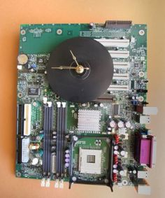 Repurposed Unique  Old Computer Motherboard Clock.................My dad makes these.  Please repin for him