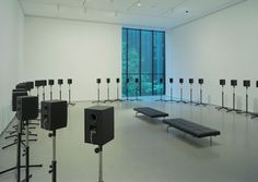 """""""The Forty Part Motet"""", 2001 by Janet Cardiff.  40 loud speakers mounted on stands, placed in an oval, amplifiers, playback computer."""