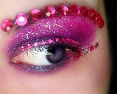 I was inspired by this photo to use little gems on the face to create a really glamourous, burlesque cat and I thought that they would look really effective to create the eyebrows or use in combination with the eyeshadow around the eyes to draw your attention to the cat's eyes. I would use pink, silver and purple colours to match the eyeshadow and cheshire cat colour scheme.