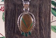 Pendant Sterling Silver Ribbon Hachita Turquoise and Emeralds