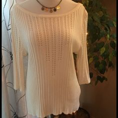 St John Ivory 3/4 Sleeve Knit Luxurious knit with stunning detail and shoulder to shoulder boatneck line. Silky and soft with substantial weight. St. John Sweaters