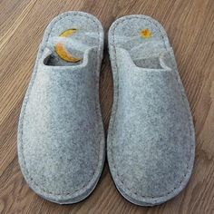 One of a kind. A pair of completely handstitched wool felt slippers with a hand needle felted moon and star on the insoles and. Made here at Joe's Toes HQ from our thick wool felt. It's one of our first Joe's Toes samples. Slip resist felt sole.  If you'd like something similar in another size or colour just drop us a line.        Please note we use UK sizes. We have an adult size conversion chart which also shows the actual length of our soles at the bottom of each page. For US sizes…