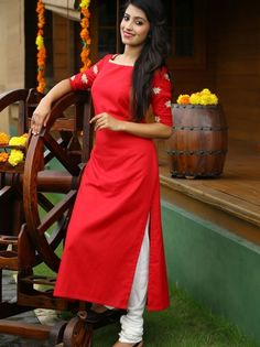 Parul - Its all about the details! Lotus embroidered handloom red kurti enhanced with line embroidery on the neckline. Simple Kurti Designs, Salwar Designs, Kurta Designs Women, Kurti Designs Party Wear, Blouse Designs, Red Kurti Design, Kurta Neck Design, Salwar Pattern, Kurti Patterns