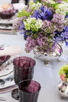 Lilac in silver teapot centerpiece. Here's a unique centerpiece idea. See how Skimbaco Lifestyle added flowers to a silver teapot! #mothersday #centerpiece