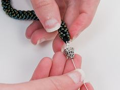 Step 12: Thread a cone onto the wire so that it is covering the end of the bracelet.
