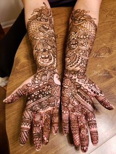 Indian bridal mehndi with peacocks and roses
