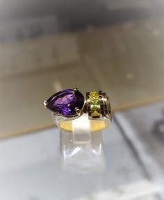Pear cut amethyst with peridots in 14k yellow gold - a Rod Stelter original http://www.rodstelterjeweler.com/