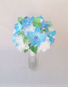 Hand made paper flower wedding bouquet with hand painted blue orchids with white paper roses and hand painted leaves