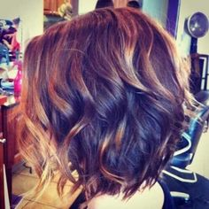 Love love love this cut and color! Beautiful chocolate brown with highlights tucked in curls.