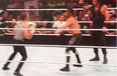 Ambrose and Reigns playin Monkey in the Middle with Seth 7/21/14 after the show went off air [gif]