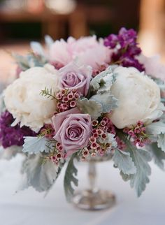 8 Exceptional Purple Color Combos purple wedding centerpieces<br> Send Cool waters in Granbury, TX from Town and Country Floral Gallery, the best florist in Granbury. All flowers are hand delivered and same day delivery may be available. Wedding Flower Arrangements, Wedding Table Centerpieces, Wedding Bouquets, Wedding Decorations, Wedding Ideas, Centerpiece Ideas, Centerpiece Flowers, Wedding Hacks, Flower Bouquets