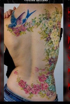 Sparrow and realistic flowers across the back and down the side. SO gorgeous. :D
