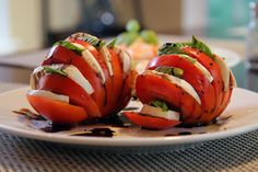 Beautiful presentation....tomato, mozzarella, basil w/ balsalmic glaze.