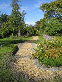 Granite setts edge this gravel country garden path from a front garden design by Sue Davis outside-rooms.co.uk