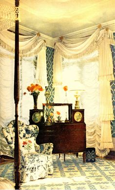 Evoking the 19th century  White cotton pique curtains with deep tasseled trimmings, tiered, festooned, shaded & swagged