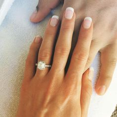 This halo engagement ring is everything a girl could ask for.
