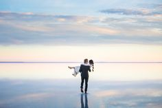 Love this bridal shot my husband(tyler rye photography) took at the Salt Flats in northern Utah! It looks like they are walking to the clouds! The reflection is so beautiful!