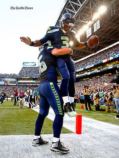 Seahawks QB Russell Wilson after his TD!! He's so Danger-RUSS!!