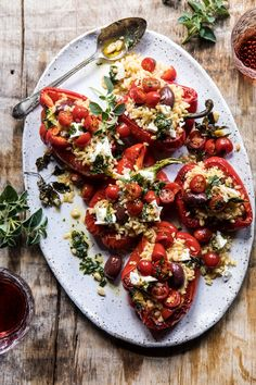 Greek Orzo Stuffed Red Peppers with Lemony Basil Tomatoes | halfbakedharvest.com #healthy #summerrecipes #easy #dinner #greek Easy Healthy Dinners, Healthy Dinner Recipes, Great Recipes, Healthy Cooking, Orzo, Red Peppers, Bruschetta, Summer Recipes, Basil