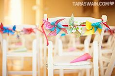 Pinwheel Streamers Accessorize these Wedding Chairs I Birds of a Feather Events I #chairdecor