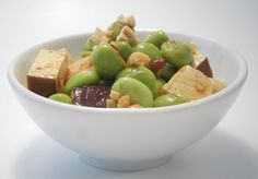 Edamame & Tofu Salad with Almonds - serves 2-4    1 cup frozen edamame peas (green soy beans), out of shell  1 block each savory baked tofu and dried tofu (or 2 of one)  1 tbsp olive oil  1 tbsp soy sauce  1 tsp sesame oil