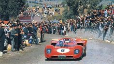 Nino Vaccarella navigates through a crowd of admirers in the third place finishing Ferrari 512S, Targa Florio, 1970.