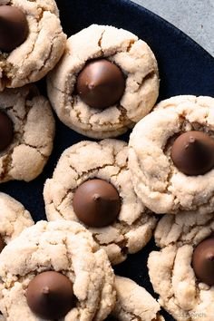 Peanut Butter Blossoms Recipe - This soft classic peanut butter cookie topped with a milk chocolate kiss is always a favorite! Peanut Butter Kiss, Classic Peanut Butter Cookies, Peanut Butter Blossoms, Fun Easy Recipes, Best Dessert Recipes, Cookie Recipes, Holiday Recipes, Popular Recipes, Holiday Treats
