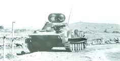 Abandoned Syrian light tank PT-76B after fights on Golan Heights, during Yom Kippur war, 1973