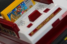 任天堂 The Nintendo Entertainment System - Family Computer ファミリーコンピュータ video game console by Nintendo during 1983. Once the best-selling gaming console of its time.  Super Mario Bros. スーパーマリオブラザーズ for over 20 years was the best-selling video game of all    Video Game Systems  Information.