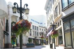 Exclusive designer stores on Rodeo Drive in Beverly Hills, CA. We browsed the stores and admired the beautiful hanging baskets from the lamp posts.